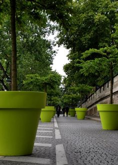huge tree planters that look like plant pots!! Thats fun!