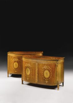 Sold for  242,500 GBP A pair of George III rosewood, tulipwood and marquetry commodes circa 1775, attributed to Mayhew and Ince the D-shaped tops with central rosette within interlaced bell flower garlands with a crossbanded and pearled edge, with two faux fluted frieze drawers and bowed cupboard doors, each inlaid with ribbon tied bell flower surrounded rosettes, enclosing four short and one long drawer Sotheby's