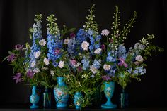 How gorgeous would this arrangement by Scarlet & Violet be at a wedding reception?  Swooning  & dreaming right now!
