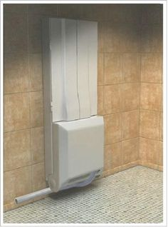 Folding Shower From Supiot.  In closed position.  Shows drainage set up.  Article (May 2013) says there is a variety of styles and colors.  Inquire http://www.supiot.fr for direct purchase.