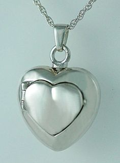 Fabulous double heart locket keepsake necklace and urn. The top screws off and you can put the cremated remains of your loved on inside or perhaps a lock of hair. $129 includes engraving. #keepsakejewelry, #jewelryurn,