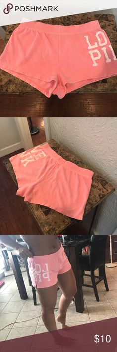 Victoria's Secret PINK shorts Victoria's Secret PINK shorts. Coral color. I believe these are a medium, but the tag has been removed. Very cute... waist can be rolled down also (shown both ways in picture) PINK Victoria's Secret Shorts