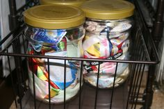 Small pieces of ribbon and trim are stored in jars.