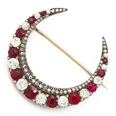 Victorian Crescent Brooch Spinel and old-mine diamond crescent brooch, set in silver and gold.French, ca. 1890.