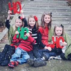 """This Christmas photo prop says it all - """"HO HO HO""""! Capture the fun and excitement of your family's Christmas joy. This festive sign photo prop makes for for a truly unique and fun family photography"""