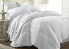 The perfect comforter to keep you cozy everymonth of the year. The All-Season Down-Alternative comforter from the Becky Cameron Collection™ features the perfect loft and down-like feel to keep you warm and toasty while you sleep. Designed for healthy living and 100% hypoallergenic for allergy sufferers, this luxury comforter presents a quality alternative to down with incredible loft and end to end baffle-box construction, preventing fiber from shifting, eliminating t...