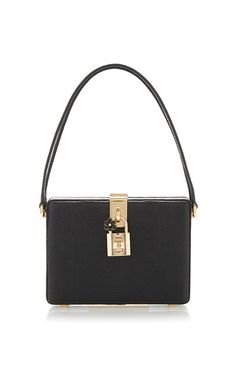 Champions of femininity and masters of sophistication Domenico Dolce and Stefano Gabbana deliver once again with this elegant **Dolce & Gabbana** box bag, crafted from lizard embossed calf leather with a suede interior, double straps and a gold clasp.