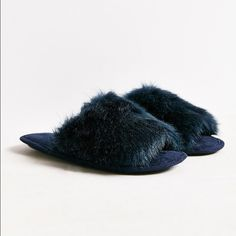 UO Dora Fuzzy Navy slippers Only worn a few times around the house. Does show some wear on them but other than that they are like new! No trades but open to offers  Urban Outfitters Shoes Slippers