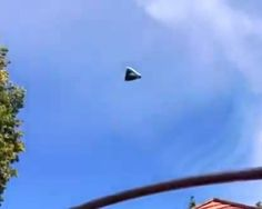 "Triangular UFO Over Kassel, Germany - Video ""This triangle UFO was seen recently and it closely resembles a TR3B. The fact that the person blurred out the face of the kid and didn't get the UFO in the dead center of the video is what causes me to believe this is real. Also the lighting and shading on the UFO matches that of the trees, and the bars of jungle gym, says Scott Waring, author of UFO Sightings Daily."