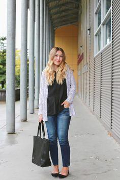 Black blouse, distressed skinny jeans, gray cardigan, black flats