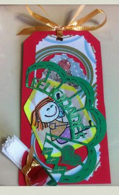 Tag for  a girl..congratulations cut in Cricut...stamp..color pencils..punched small green tag..
