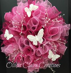 Curly Deco Mesh Wreath in fuchsia and baby pink mesh with crystal picks and delicate white butterflies. Precious! This one was for a customer but I liked it so much I've made another and it's available at my Etsy Shop!