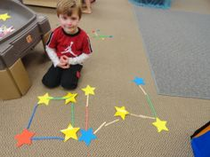 Constellation building with paper stars, craft sticks and straws