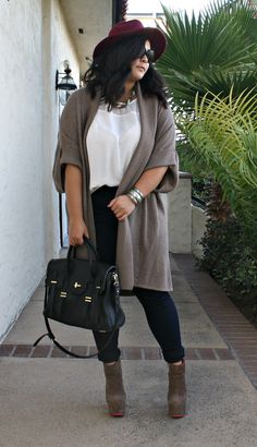 Plus size knit sweater and platform booties. A perfect fall outfit topped off with a burgundy  fedora.