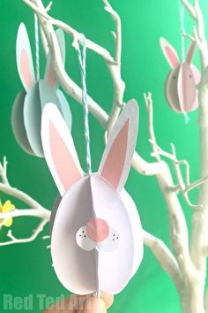 Easy Paper Bunny Craft - Bunny Easter Decorations> Cute and easy Easter bunny ornaments. Love simple paper crafts like this. So fun!