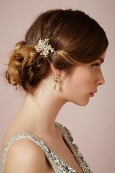 A vintage bridal hairstyle with a small sparkling comb tucked into it. Wedding perfect.
