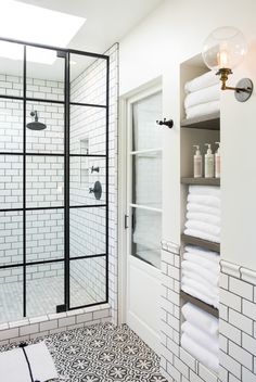 White and black bathroom boasts an alcove filled with shelves holding towels alongside a white and black floor in Cement Tile Shop Bordeaux Tiles. More I like this set up and design! Bathroom Inspo, Bathroom Inspiration, Bathroom Ideas, Design Bathroom, 1930s Bathroom, Bathroom Interior, Modern Bathroom, Shower Ideas, Natural Bathroom