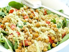 Spinach Salad with Quinoa, Crispy Chickpeas, Tomato, and Avocado Basil Dressing.  A hearty, filling salad that can be a meal in itself!  Easy healthy recipe.