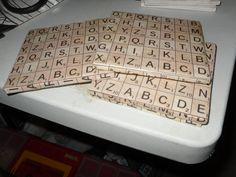 scrabble coasters made out of floor tiles