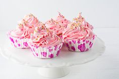 Decorated pink birthday cupcakes  on the cake stand