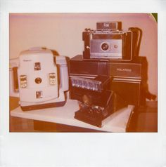 Pictures of Polaroid cameras with... a Polaroid camera? Ironic. :)