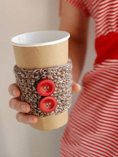 Cup cozy from old sweaters and buttons. Give this with a nice reusable cup and coffee house gift card...