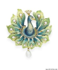 Art Nouveau enamel, diamond and pearl peacock brooch.  Nouveau 1910 Collection available (gorgeous reproduction pieces using original Nouveau designs-- hand crafted in Barcelona)