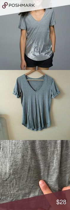 Lululemon love tee Lululemon love tee with shimmery bottom. Small hardly noticeable stain that blends in with the shimmering. Size 4 lululemon athletica Tops Tees - Short Sleeve