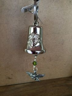 This is a unique and different motorcycle bell or gremlin bell. It has the traditional bell with The marines logo on the bell. I hung an olive green crystal bead and an eagle on the bottom. Everything added is triple wire wrapped for added protection. There are many other styles available at my shop. Custom orders can be done for 20.00.  This bell come in a silk like bag and with a black cord and key ring.  Thanks for shopping RealBeadDesigns