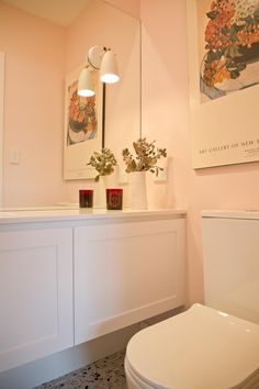 Powder rooms often seem to a space where clients mix it up and this was no exception, with the peachy pink walls it's a groovy number!