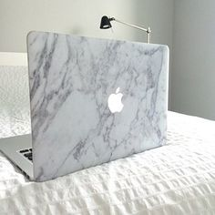 This marble laptop cover that will make you feel sophisticated and classy even when you're eating Cheetos and watching Netflix in bed. | 21 Things You'll Want If You Love Being Fancy