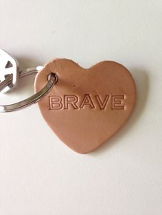 Handstamped BRAVE leather heart key fob on Etsy, $11.00