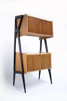 mid century modern Louis Paolozzi; Italian Oak, Ebonised Wood and Brass Wall Unit, 1950s.