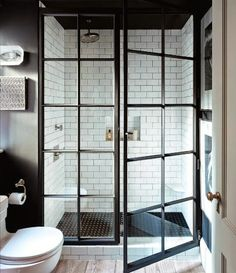 I like the idea of the industrial shower door (fewer mullions) and white subway tiles with dark grout (not in this picture)