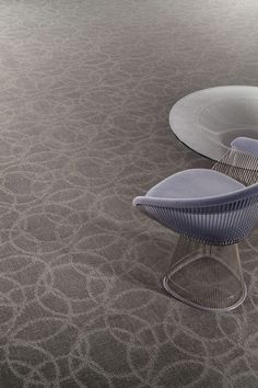 The Next Dimension collection in the Round and Round II pattern and the Bosonic String colorway. #design #broadloom #carpet #flooring #interiordesign #geometric #circles