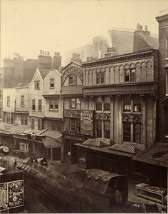 This row of shambles was destroyed for the extension of the Metropolitan Railway from Aldgate to Tower Hill, 1883.