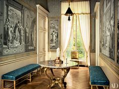 STUDIO PEREGALLI. TABLE: LOUIS XV MARBLE-TOP TABLE. WALLS: ANTIQUE GRISAILLE PANELS. HAND-PAINTED BOARDERS. http://www.architecturaldigest.com/gallery/studio-peregalli-ad100#2
