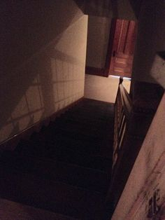 Looking down the staircase from the Attic door into the servants wing. The door at the bottom (pictured) is Lena Peterson (later Olson)'s bedroom. She was head cook from 1910-1911. | James J. Hill House