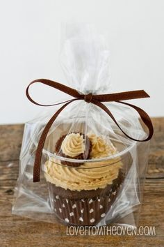 Cupcakes - Need to package individual Cupcakes? Put them in a clear plastic cup, put the cup in a bag, tie with a ribbon
