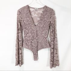 b21509e8c5 TOBI Grand Central Thong Bodysuit Mauve lace Plunging neckline Lined bodice  Sheer bell sleeves Sheer back