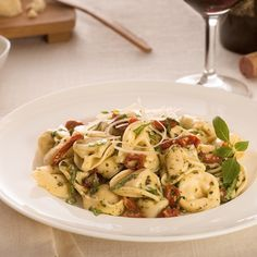 Garlicky pesto and rich sun-dried tomatoes make this tortellini irresistable. This is an easy dish for a picnic or potluck.