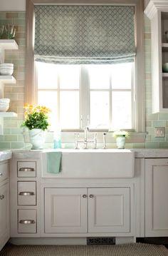 Turquoise backsplash, over sized drawer pulls, monochromatic, open shelf