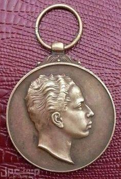 ميدالية ذهبية صدرت في 3 مايس 1953 لمناسبة اعتلاء فيصل الثاني يرحمه الله عرش المملكة العراقية