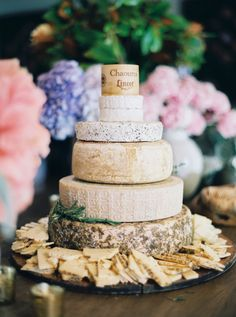 A 'cheese' cake: http://www.stylemepretty.com/living/2015/08/24/floral-infused-50th-birthday-celebration/   Photography: Sarah Kate - http://sarahkatephoto.com/