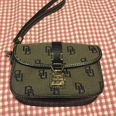 Dooney & Bourke wristlet. Black jacquard D&B wristlet. In great shape. Dooney & Bourke Bags Clutches & Wristlets