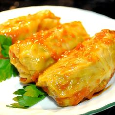 Stuffed Cabbage Rolls | Cabbage leaves filled with ground beef and rice are simmered in tomato soup for this Polish-inspired favorite.