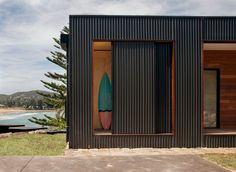 This prefab home in Australia has a storage space just for surfboards.