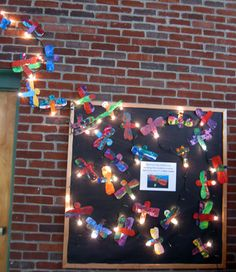 The Very Lonely Firefly, by Eric Carle library book display using a string of white lights