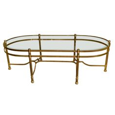 oval brass coffee table with mirrored rim glass top | tables