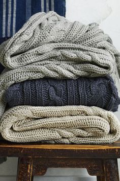 Thick cable-knit blankets are a great way to cuddle up in bed when it cools down. (Source: www.refinery29.com.)